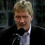 Eric Mecking bij microfoon